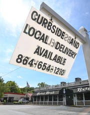 A sign on the road for Pixie & Bill's restaurant lets customers know online menu items can be ordered for curbside pickup at Pixie & Bill's on S.C.123 in Clemson, as well as delivery. Pixie & Bill's is one of several iconic restaurants for Clemson area residents and students which adjusted to the COVID pandemic.