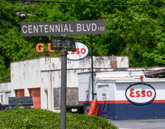 A bird flies away from a Centennial Boulevard sign near The Esso Club on S.C. 93, which has been closed since March 18 in Clemson. Many Clemson iconic popular eateries have adjusted to not having students on campus because of the COVID pandemic, some closed until further notice and others offering limited hour curbside pick up from menus listed online.