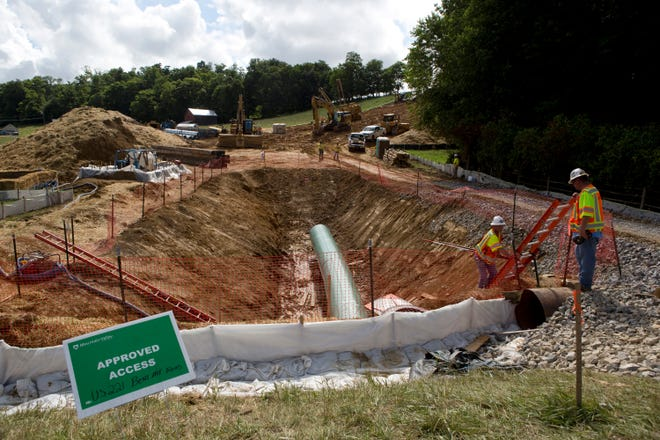Construction crews bore beneath U.S. 221 in Roanoke County, Va., on June 22, 2018, to make a tunnel for the Mountain Valley Pipeline. [Roanoke Times file photo via AP]
