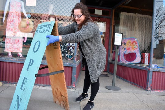 Nicole Snider opens the Northern Treasure thrift store on Monday, April 27, 2020 in Roundup, Mont. The store had been closed for a month under a coronavirus directive from the state's governor. (AP Photo/Matthew Brown)