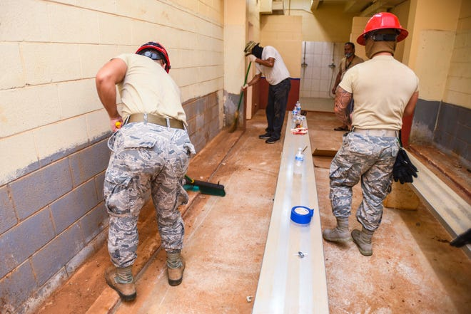 Guam National Air Guard 254th Red Horse Squadron personnel and Department of Parks and Recreation employees work together to renovate one of the locker rooms at the Paseo Stadium in this April 29 file photo. Paseo Stadium was determined not to be ideal to limit the spread of COVID-19 as a temporary homeless shelter.