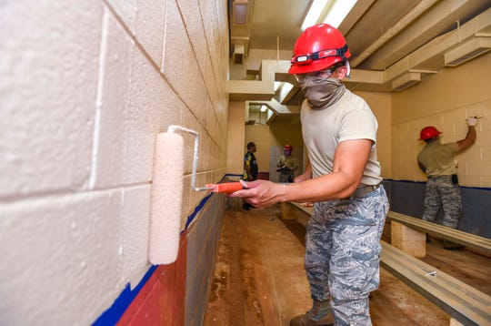 """Senior Airman Vince Sablan and fellow Guam National Air Guard 254th Red Horse Squadron personnel add a fresh coat of paint to one of the locker rooms at the Paseo Stadium in Hagåtña on Wednesday, April 29, 2020. The Guard members, along with employees from the Department of Parks and Recreation, Department of Public Works, other agencies, and nonprofit organizations, are coordinating their efforts in """"Operation Safe Haven"""" to prepare the venue as a temporary shelter for the island's homeless population during the coronavirus pandemic."""