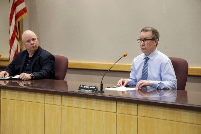 Dr. Jeremy Adler, Tippecanoe County's health officer, right, speaks during a press conference at the Tippecanoe County Office Building, Wednesday, April 29, 2020 in Lafayette.