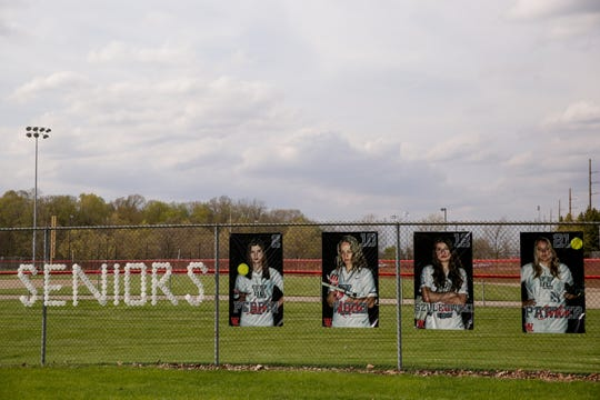"""Seniors"" is spelled out of cups in the right field fencing next to pictures of senior softball players at the West Lafayette High School Sports Complex, Tuesday, April 28, 2020 in West Lafayette."