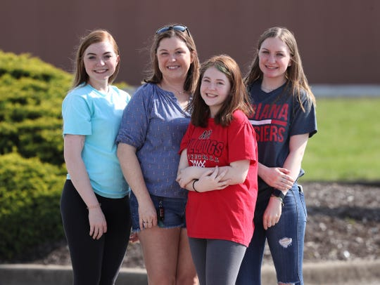 Jennifer Logsdon, second from left, with her daughters; from left, Jayla, 18, Julia, 14, and Jordyn, 16, in New Albany, In. on April 28, 2020.  They have to visit Jennifer's mom from a safe distance outside the Diversicare of Providence facility because of concerns about exposure to the coronavirus.