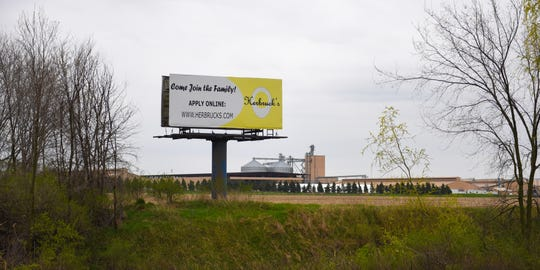 A billboard near the Ionia exit to prospective employees for Herbruck's Poultry Ranch seen from eastbound I-96 Wednesday, April 29, 2020. [MATTHEW DAE SMITH/USA Today Network]