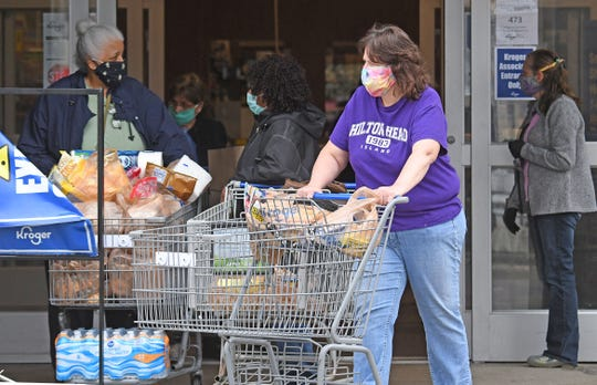 Some Kroger customers have opted to wear masks or other facial coverings when shopping.