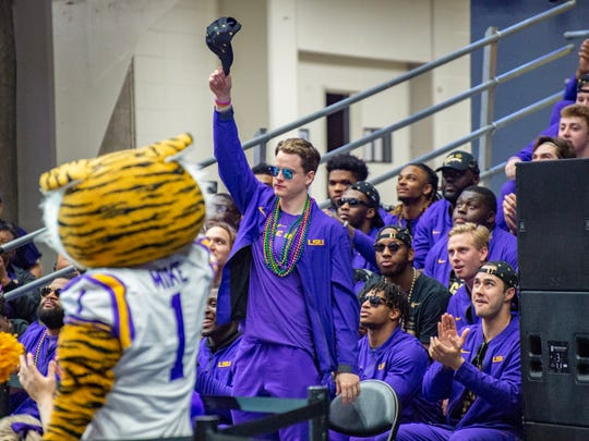 LSU quarterback and Ohio State graduate Joe Burrow waves to the crowd during the Tigers' national championship celebration and parade.