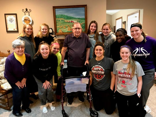 Jerry Widder, center, and his wife, Judy, bottom left, take a photo with the 2019-20 Ohio Cardinal Conference champion Lexington Lady Lex. Jerry Widder passed away on April 24.