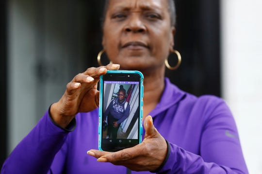 Leslie Shaw holds a photo of her granddaughter, 14-year-old Casha-Mona, who she is raising from their Raleigh Court Townhome in Memphis, trying to balance her safety from the coronavirus with her  granddaughter's desire to go to parties and sleepovers with friends.