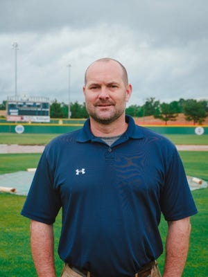 Brad Smith is head baseball coach at Arlington High School