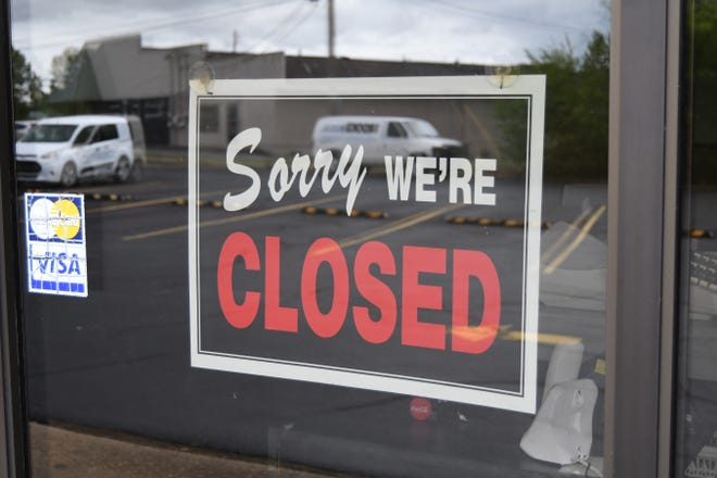 A closed sign hangs in the window of a restaurant of a diner in Mountain Home on Wednesday.