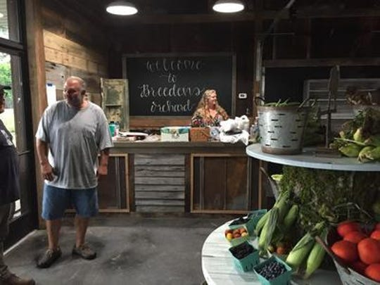 Andrew Dorfman and wife Aimee Dorfman, right, bought Breeden's Orchard in 2017. The store was destroyed by fire on April 29, 2020.