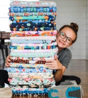 Lucy Blaylock, 11, has made hundreds of masks to donate to local healthcare workers during the COVID-19 pandemic.