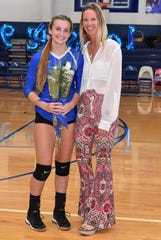 Madylin Marino, left, played for her mom, coach Andrea Marino, on the Wood-Ridge volleyball team.