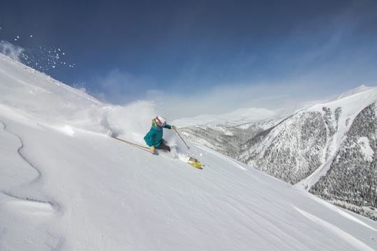 Skier enjoying powder at Arapahoe Basin in Colorado last spring. The resort typically closes late in the season and is keeping its mountain prepared in the event local public health officials allow it to reopen later this spring.