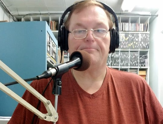 Deming radio DJ John Krehbiel at the mic for KOTS-AM 1230 and KDEM-FM 94.3.