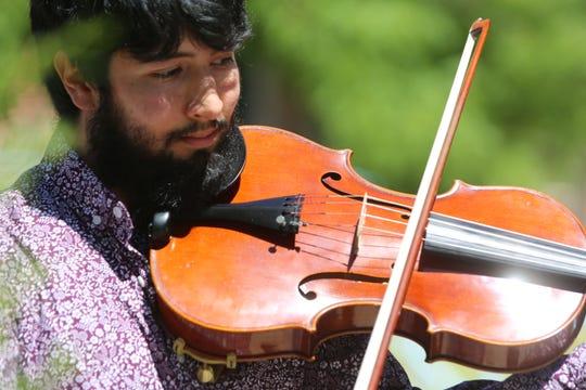 Camerata del Sol member Julio Campos plays his violin on the lawn of Good Samaritan Society of Las Cruces, Wednesday April 29, 2020.