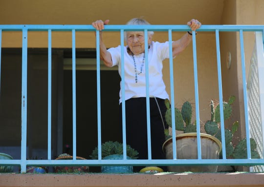 Good Samaritan resident Virginia Beattie, on her balcony, listens to a performance from members of Camerata del Sol on Wednesday, April 29, 2020.