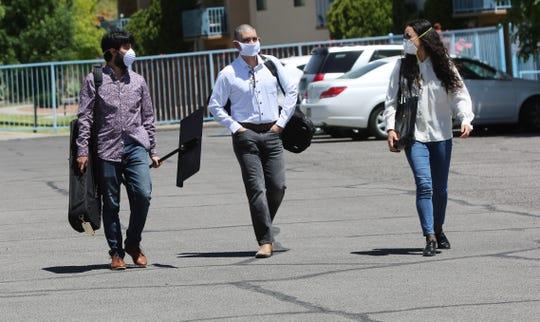 Julio Campos, left, Daniel Vega-Albela and Amalia Zeitlin, of Camerata del Sol, arrive at Good Samaritan Society of Las Cruces Wednesday, April 29, 2020.
