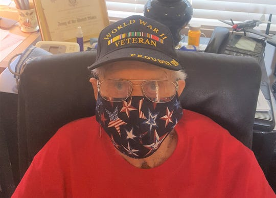 Sun City Palm Desert resident Adolph Gonzalex, 99, wears a patriotic mask made for him by Anne Cole