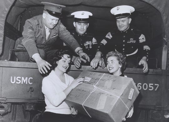 In this historical photo, Sara O'Meara and Yvonne Fedderson, former actresses who founded Childhelp in 1959, work with the Marines to collect supplies for orphans.