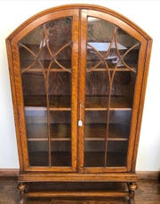 Large furniture pieces like this arts-and-crafts bookshelf often include a substantial shipping premium when bought online at auction.