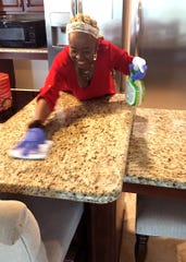 Willia Darnes cleans the tables at The Arc Gateway's group home kitchen in Pensacola on Tuesday, April 28, 2020.