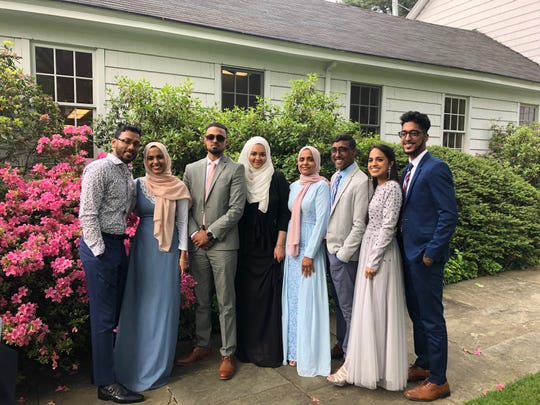 The Yasin family poses together. From left: Amirah Yasin and her husband, Sameer, Ismail Yasin and his wife Sumaiyah, Safiyah Yasin and her husband Mohamed, Aneesah Yasin and her brother Adam Yasin.