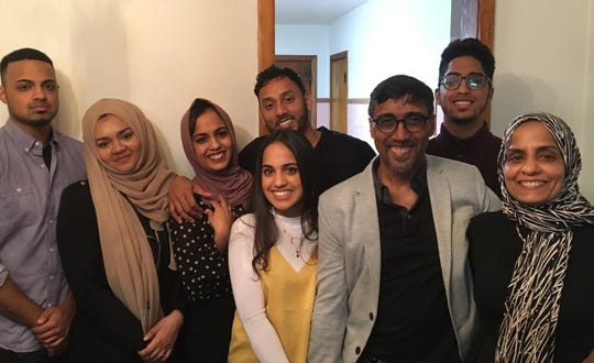 The Yasin family poses together inside their Union Vale home along with Amirah and Ismail's spouses.