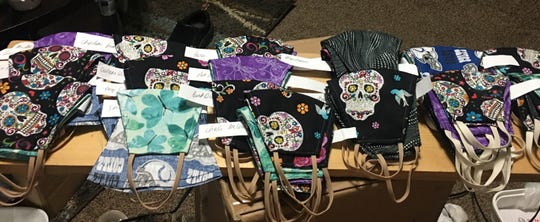 Angie Loaiza sews protective masks in a variety of styles and colors that she gives away during the coronavirus COVID-19 crisis.