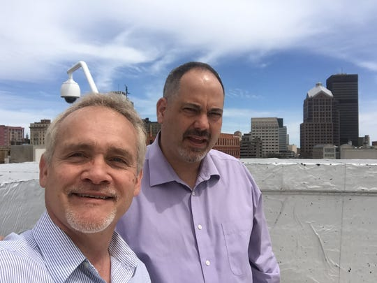 Leo Roth and Steve Bradley on the rooftop of the Gannett Building at 55 Exchange Boulevard in April 2016, saying goodbye to the old building before moving to the current location on Main Street. Roth and Bradley are leaving the Democrat and Chronicle on May 1.