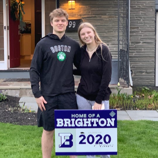Andrew Iker, Brighton Class of 2020, receives lawn sign as he celebrates commitment to attend University of Pittsburgh.