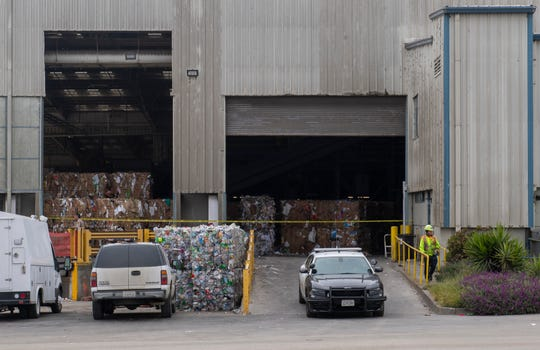 An employee walks near the Material Recovery Facility inside the Regional Waste Management District on Wednesday, April 29, 2020.