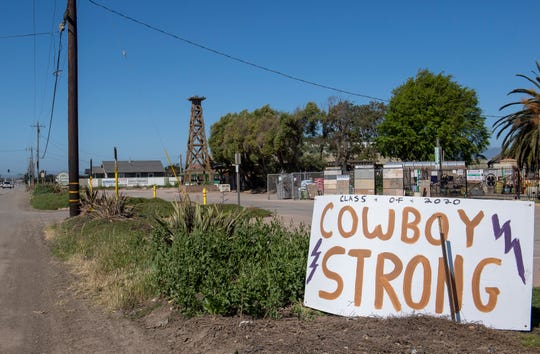 """Several Salinas High School teachers put up signs around South Salinas to spread encouragement and positivity. A sign that reads """"class of 2020 cowboy strong"""" is placed near McShane's Landscape Supply on Tuesday, April 28, 2020."""