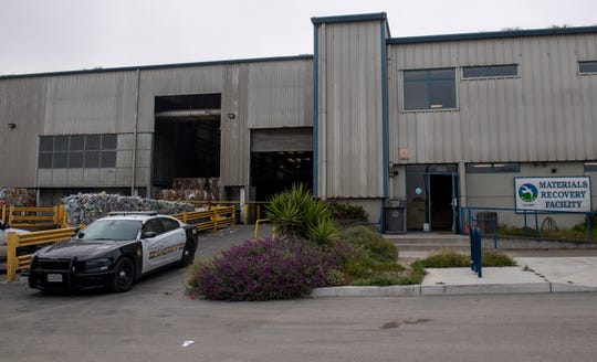 A Monterey County sheriff's car is parked by the Material Recovery Facility where a Regional Waste Management District employees said the body of the infant child was found.