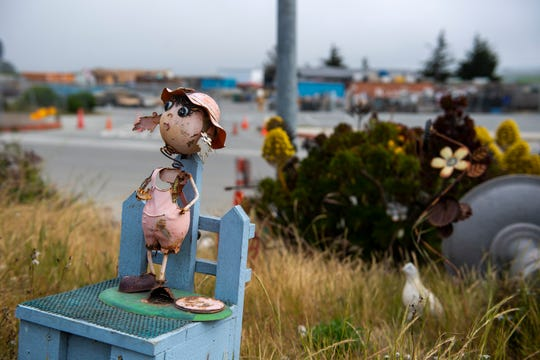 A rusted toy girl figurine is placed near other rusted items inside the Regional Waste Management District on Wednesday, April 29, 2020.