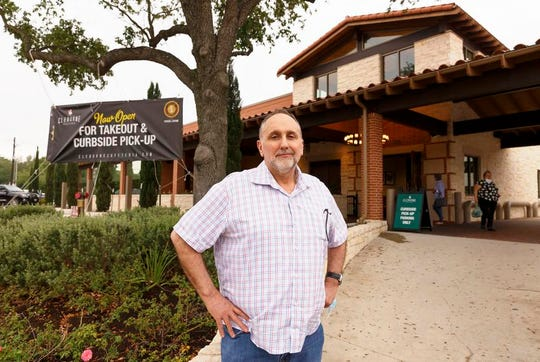 Cleburne Cafeteria owner George Mickelis outside his restaurant on April 28, 2020. The restaurant has been open for carry out, but is preparing to open with limited seating on May 1 following Gov. Greg Abbott's decision to allow reopening of some businesses.
