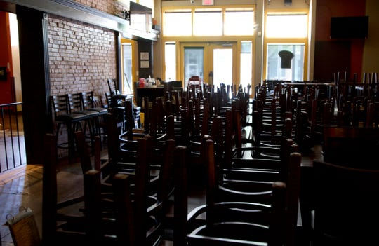 Chairs fill the dining room at Zero One Ale House in downtown San Angelo, seen in this Tuesday, April 28, 2020 photo, amid restrictions due to coronavirus.