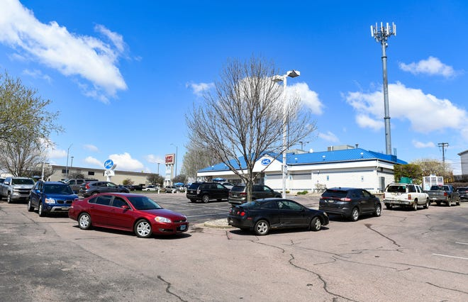 Cars line up in the Culver's drive-thru lane in Sioux Falls, S.D. Business is booming for many fast-food chains and other restaurants where customers are in and out in minutes.