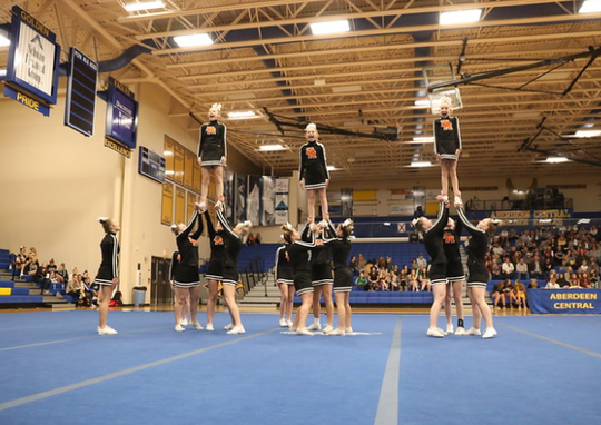 The Dell Rapids competitive cheer team competes in the state meet at Aberdeen Central last October.