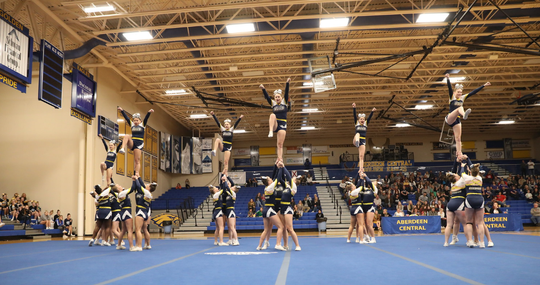 The Sioux Valley competitive cheer team competes in the state meet at Aberdeen Central last October. The Cossacks have won 13 straight Class A titles.