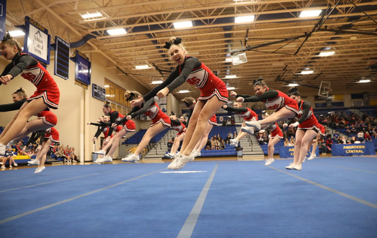 The Dell Rapids St. Mary competitive cheer team competes in the state meet at Aberdeen Central last October.