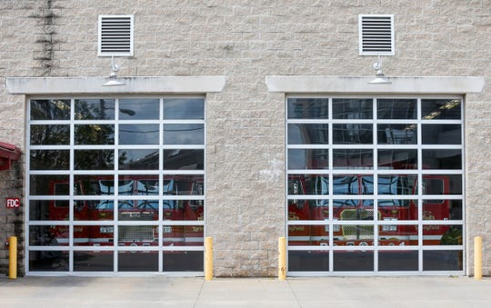 The firetrucks at Springfield Fire Station 1 sit behind the glass garage doors on Wednesday. The fire department has closed its stations to the public and is not responding to many ambulance calls during the coronavirus pandemic.