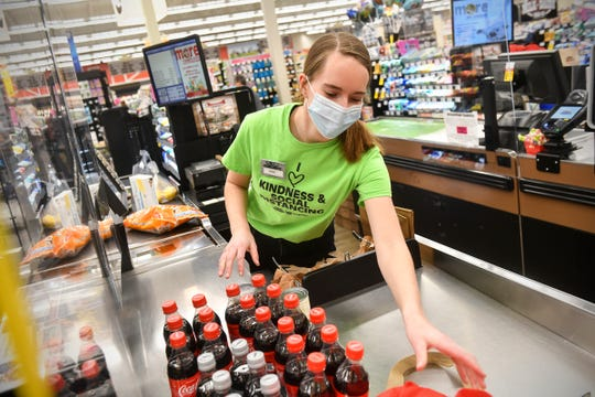 Emily Schlangen bags groceries  Wednesday, April 29, 2020, at the Pinecone Road Coborn's Marketplace in Sartell.