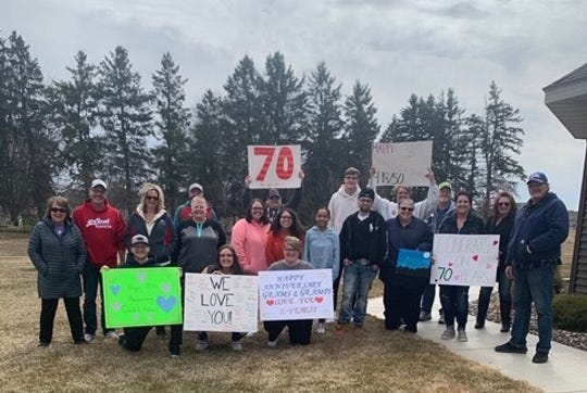 Family of Carol and Hobbie Schleicher celebrated their 70th anniversary while practicing social distancing Saturday, April 18, 2020, outside Serenity Place on Seventh in St. Joseph.