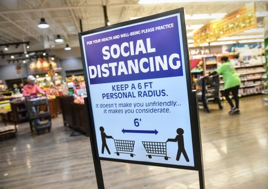 A sign reminds customers of social distancing guidelines  Wednesday, April 29, 2020, at the Pinecone Road Coborn's Marketplace in Sartell.
