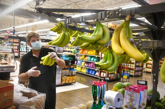 Chris Conrad stocks fresh produce  Wednesday, April 29, 2020, at the Pinecone Road Coborn's Marketplace in Sartell.