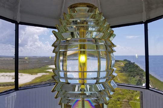 A replica Fresnel lens will shine again inside the St. Marks Lighthouse starting May 2. The last time it was lit was in 2000.