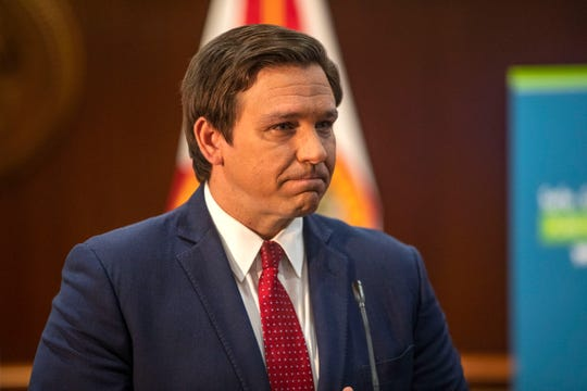 "Gov. Ron DeSantis fights back tears after being asked about his family. His daughter Mamie, who was born in March, has not been held by her grandparents or extended family since she was born. Earlier DeSantis announced his ""Safe. Smart. Step-by-Step. Plan for Florida's Recovery"" during a press conference Wednesday, April 29, 2020."
